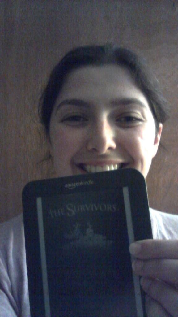 selfie reading book Kindle